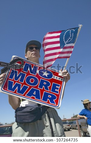 MARCH 2005 - Picture of anti-Bush political rally in Tucson, AZ with sign reading No More War - stock photo