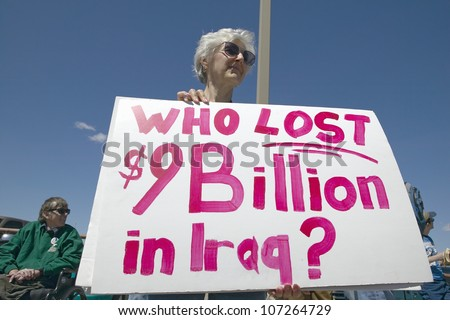 MARCH 2005 - Picture of anti-Bush political rally in Tucson, AZ with signs about Iraq War in Tucson, AZ - stock photo