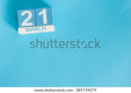 March 21st. Image of march 21 wooden color calendar on blue background.  Spring day, empty space for text. World Down Syndrome Day, International DAy Of Forests - stock photo