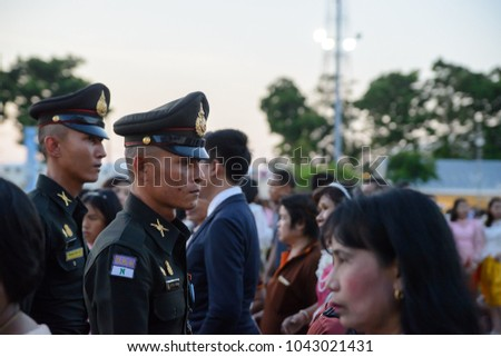 March 3, 2018. Two army infantry officers in official dress uniforms march through a crowd at the Ananta Samakhom Throne Hall, Bangkok, Thailand. Travel and security editorial.