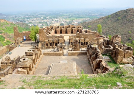 MARDAN, PAKISTAN - MARCH 31 2015: Takht-i-Bahi is a Buddhist ruins dating to the  early first century BC and is located on the top of a hill.    - stock photo