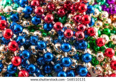 Mardi gras beads isolated on white. - stock photo
