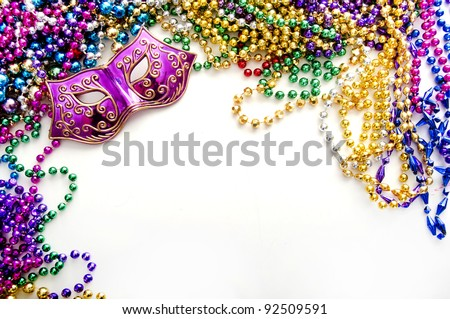 mardi gras mask and beads for party - stock photo