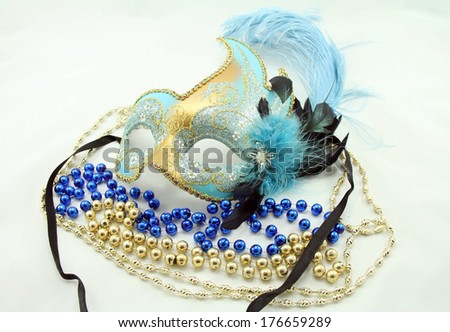 Mardi Gras mask with jewels and beads isolated on white background. - stock photo