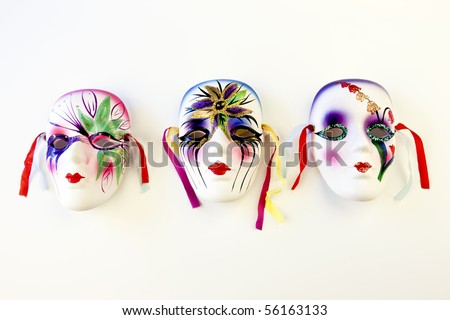 Mardi gras masks over a white background - stock photo