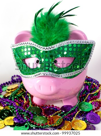 Mardi Gras piggy bank with colorful beads & coins - stock photo