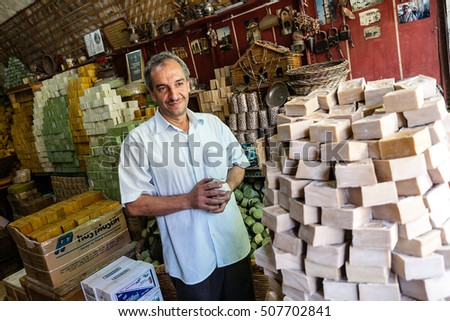 Mardin, Turkey - September 19, 2011: An unknown people in popular Turkish small shop making hand-made soap.