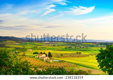 Maremma, rural sunset landscape. Countryside farmland and green fields. Tuscany, Italy, Europe. - stock photo