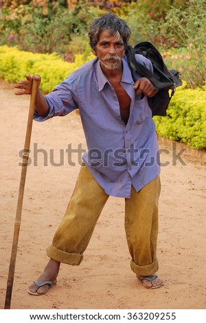 MARGAO, INDIA - N0VEMBER 20, 2007: Unidentified tramp in the city park - stock photo