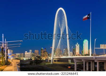 Margaret Hunt Hill Bridge and Dallas City skyline at twilight, Texas - stock photo