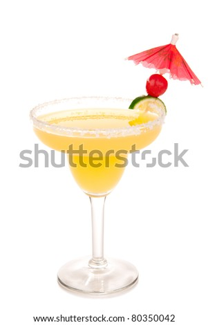 Margarita cocktail in chilled salt rimmed glass with tequila, orange, apple, triple sec, juice, simple syrup and crushed ice garnished wedge of fresh lime and umbrella in cocktails glass on white - stock photo