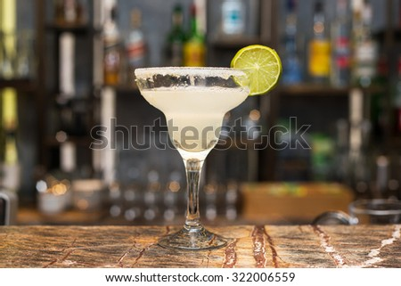 Margarita cocktail on bar counter - stock photo