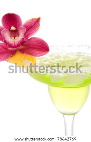 Margarita cocktail with beautiful orchid flower in chilled salt rimmed glass with tequila, orange syrup, fresh mint, pineapple, crushed ice in cocktails glass isolated on white background - stock photo