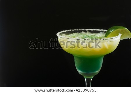Margarita cocktail with lime against black background /Green Margarita, selective focus