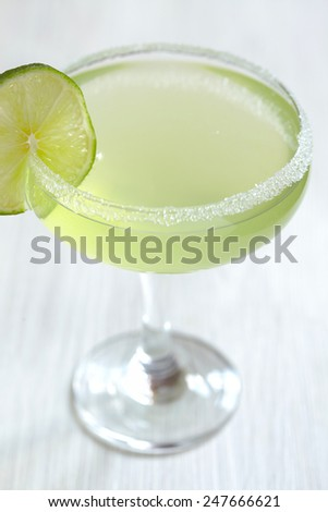 margarita cocktail with lime on white table - stock photo