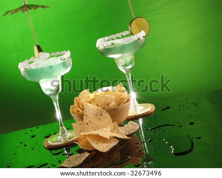 Margarita cocktails and tortilla chips - stock photo