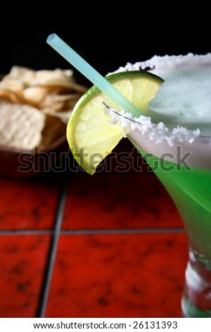 Margarita drink with tortilla chips in background - stock photo