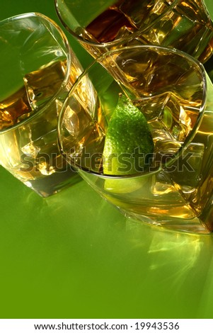 Margarita on the Rocks or Scotch on the rocks on green background - stock photo