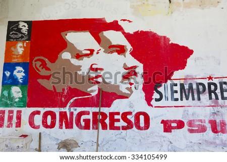 MARGARITA, VENEZUELA, APRIL 18: Political red grapffiti of Hugo Chavez and Nicolas Maduro on a wall in Pampatar, Venezuela 2015 - stock photo