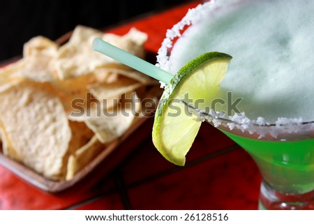 Margarita with nacho chips - stock photo