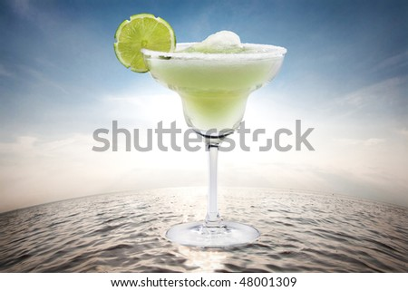 Margaritas with lime on water - stock photo