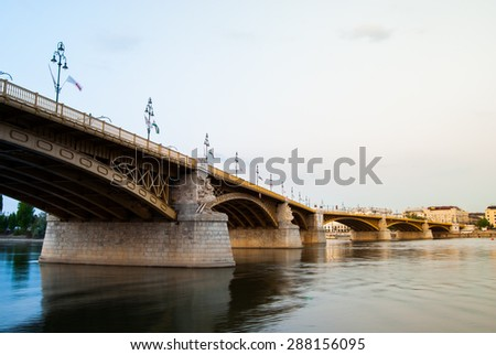 Margit or Margaret Bridge (sometimes Margit Bridge) in Budapest, Hungary. It connects Buda and Pest across the Danube. In calm grey light of a sunset. - stock photo