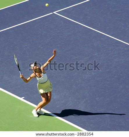 Maria Sharapova serving the ball at Pacific Life Open - stock photo