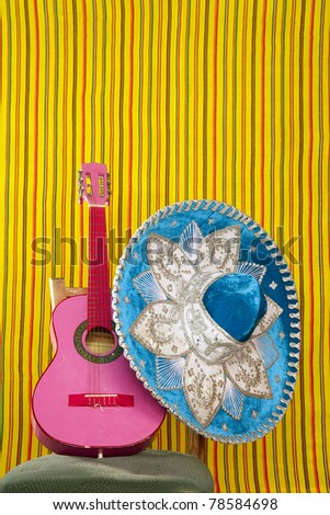 mariachi embroidery mexican hat pink guitar in striped background - stock photo
