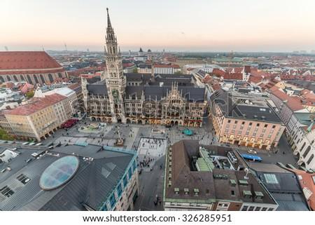 Marienplatz, Munich City, Germany, Beautiful Panorama Aerial view of Munchen sunset panoramic architecture: Marienplatz, New Town Hall and Frauenkirche at Dusk, Bavaria, Munich, Germany.  - stock photo