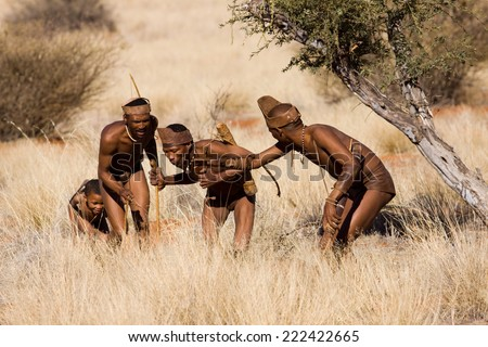 MARIENTAL, NAMIBIA - AUGUST 19: san bushmen family show people how they live in the kalahari desert in Namibia august 19, 2013 in Mariental, Namibia - stock photo