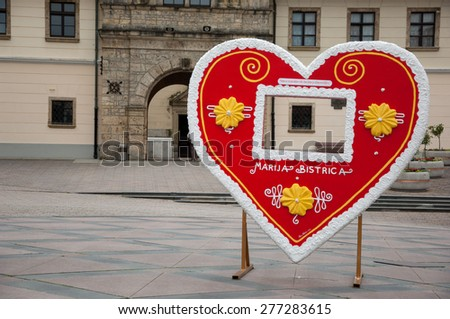 Marija Bistrica, Croatia - May 1, 2015: Traditional Licitar heart cookie in front of the Basilica of the Assumption of the Virgin Mary. - stock photo