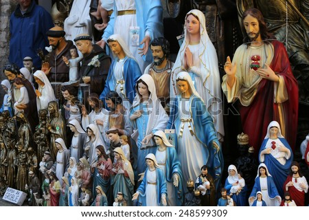 MARIJA BISTRICA, CROATIA - OCTOBER 26, 2013: Catholic Religious items, figurines of saints in one of the Souvenir shops in  pilgrimage Sanctuary Assumption of the Virgin Mary - stock photo