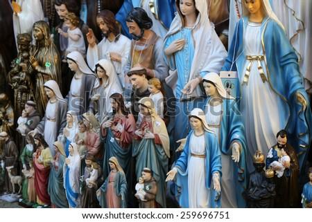 MARIJA BISTRICA, CROATIA - OCTOBER 26, 2013: Catholic Religious items figurines of saints in one of the Souvenir shops in pilgrimage Sanctuary Assumption of the Virgin Mary in Marija Bistrica, Croatia - stock photo