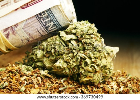 Marijuana and Cannabis Buds and Money, Drug Business American and Foreign Currency - stock photo