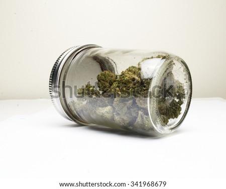 Marijuana and Cannabis in Glass Jar  - stock photo