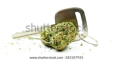 Marijuana and Car Key, Driving High On Cannabis, Drugs White Background  - stock photo