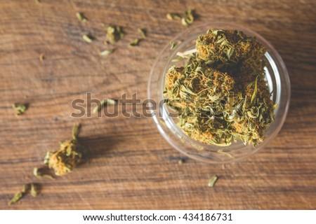Marijuana buds in the glass plate - stock photo