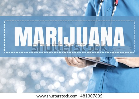 Marijuana text on medical doctor blur lights background.