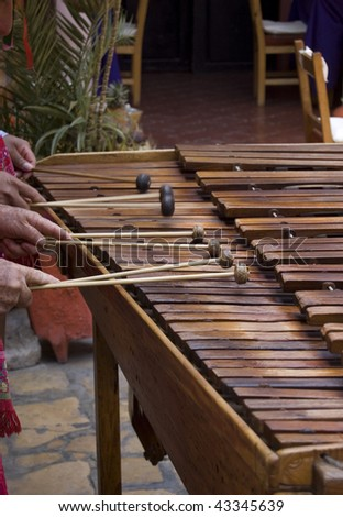 Marimba players in Chiapas, Mexico playing music.