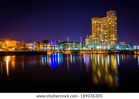Marina and apartment building at night in Baltimore, Maryland. - stock photo