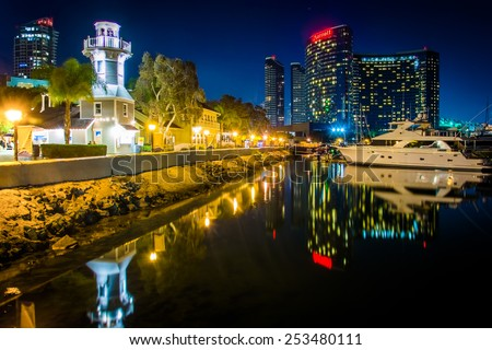 Marina and buildings reflecting at the Embarcadero at night in San Diego, California.