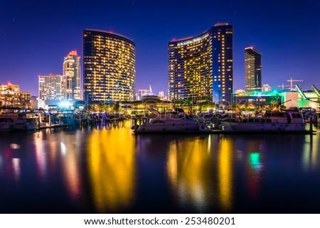 Marina and buildings reflecting at the Embarcadero at night in San Diego, California. - stock photo