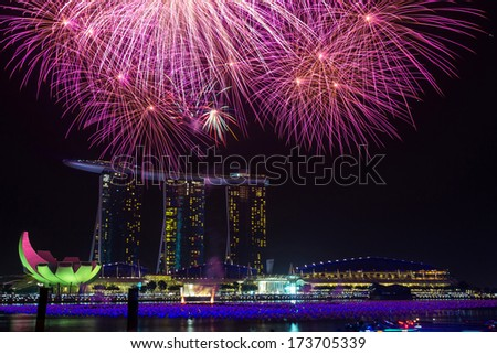 MARINA BAY, SINGAPORE - JAN 01, 2014: New year eve fireworks at Marina Bay Sands Resort Hotel in Singapore. It is billed as the world's most expensive standalone casino property.  - stock photo