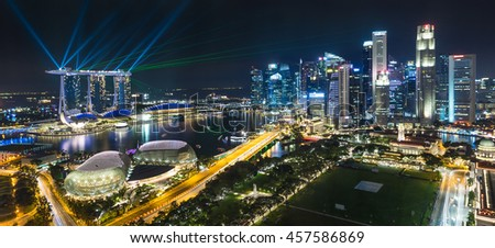 MARINA BAY, SINGAPORE - JULY 16: Singapore skyline from aerial view during Marina Bay Sand laser show on the July 16,2016 in Singapore - stock photo