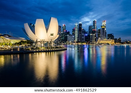MARINA BAY, SINGAPORE - JUNE 26, 2016: A beautiful blue hour at Marina Bay with Singapore Art-science museum at the background, one of the beautiful architecture in Singapore.