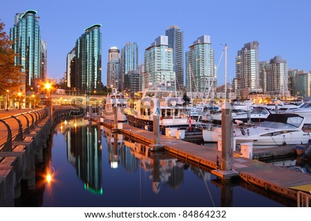 Marina Dawn, Coal Harbor, Vancouver. A marina and condominiums in downtown Vancouver's upscale Coal Harbor. - stock photo