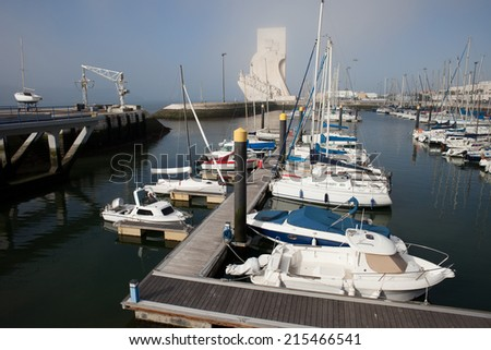 Marina in Belem district of Lisbon in Portugal and Monument to the Discoveries at the far end. - stock photo