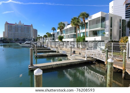 marina lined with residential condominiums in sarasota, florida - stock photo
