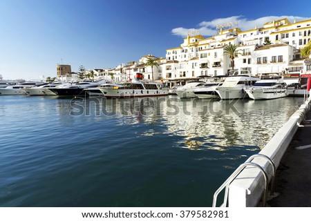MARINA OF PUERTO BANUS - CIRCA OCTOBER 2015 - Luxurious yachts in Puerto Banus near Marbella on Costa del Sol, Andalusia, Malaga province, Spain - stock photo