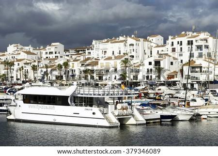 MARINA OF PUERTOO BANUS - OCTOBER 2015 - Luxurious yachts in Puerto Banus near Marbella on Costa del Sol, Andalusia, Malaga province, Spain - stock photo
